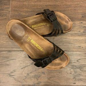Black Birkenstock slide sandals
